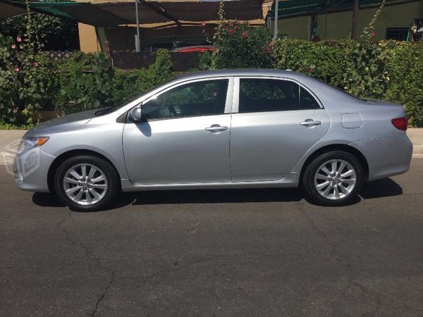 Toyota corolla , silver, importado -10